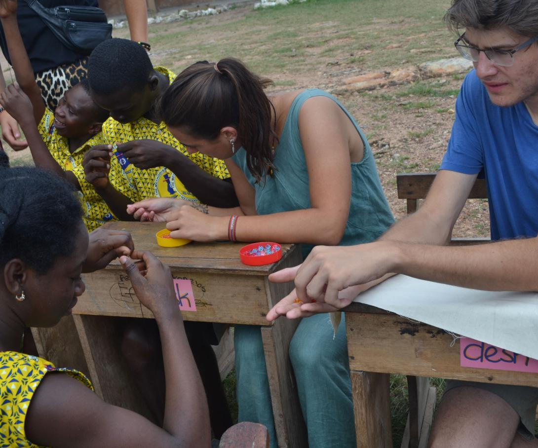 A group of gap year students teach beading at a special needs school in Africa.